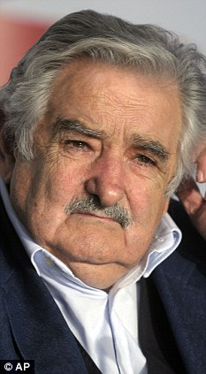 Under pressure: Recent security concerns have taken a toll on the already dipping popularity of leftist President Jose Mujica, pictured