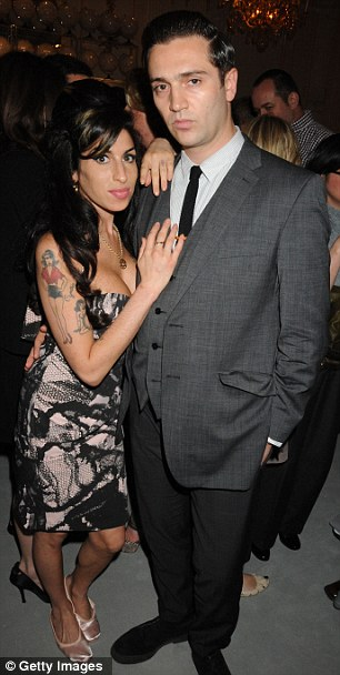 New love: Amy with Reg Traviss in 2010