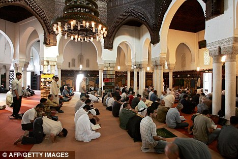 Muslims praying at the Paris great Mosque: Many people regularly drink Cola because their religion forbids them from drinking alcohol