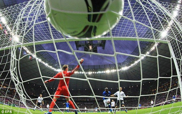 Hands up: Neuer was uncharacteristically slow, letting Balotelli's header past