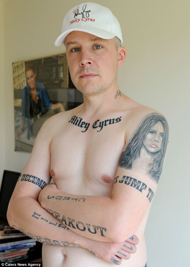 Obsession: Carl McCoid has 15 tattoos of Miley Cyrus on his body including a six inch portrait of her on his left arm