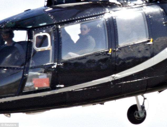 The show must go on: Tom Cruise was spied on a helicopter, taking off from Reykjavik airport, following his divorce from Katie Holmes