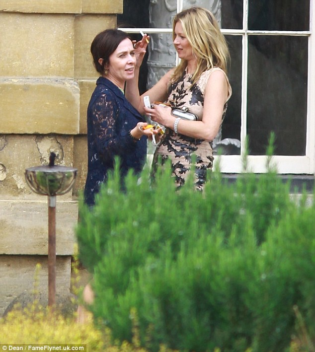 Smoking buddies: Kate and her pal chatted and puffed away outside