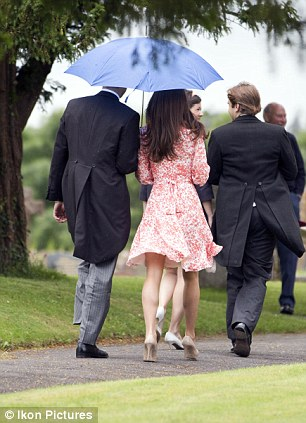 Rain fell as the guests headed into the church