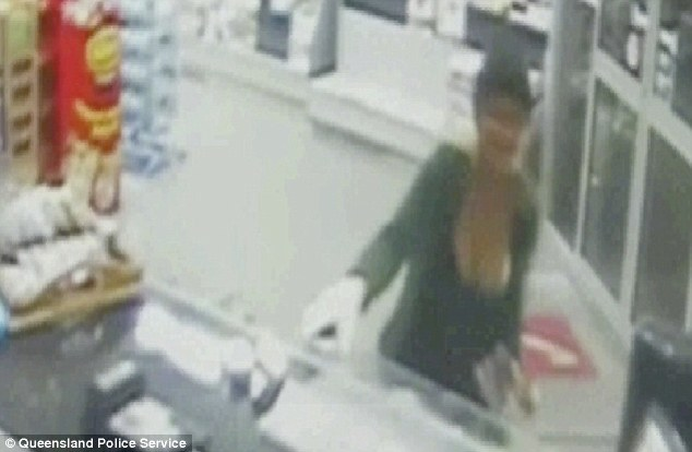 Blunders: The robber failed to hide her face and, while she wore a single glove, she used her ungloved hand to snatch cash from the petrol stations till