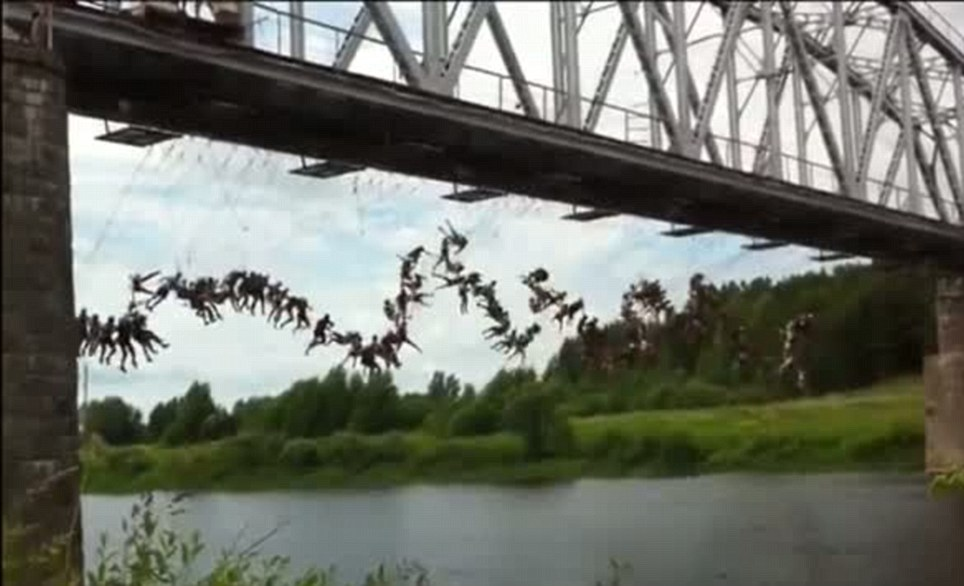 Leap of faith: 135 people were attached to a bridge in Russia and made to fall simultaneously