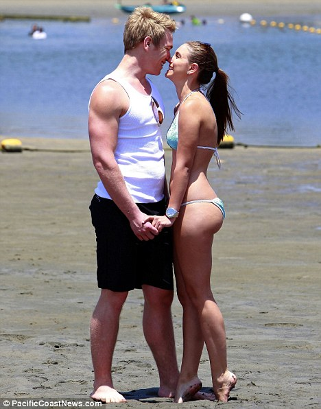 New squeeze? The pair appeared giddy in each other's company as they frolicked on the sand in Marina del Rey