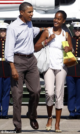 Overgrowing dad: Nearly as tall as her president father, Malia walks to Air Force One in Cape Cod on August 29, 2010