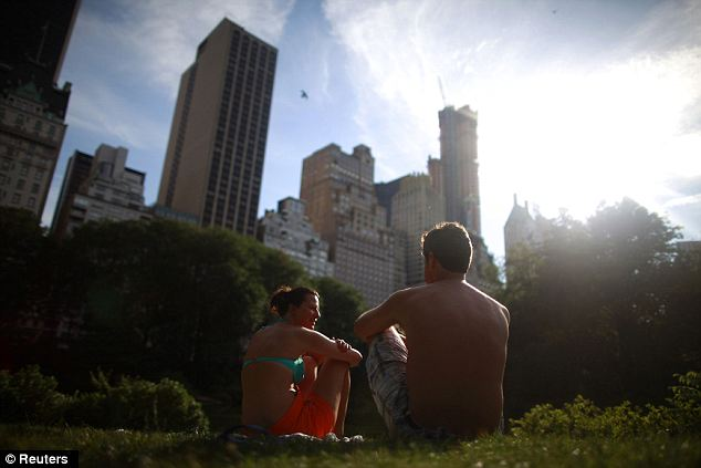 Sun in the city: Young New Yorkers took refuge in Central Park as temperatures continued to soar