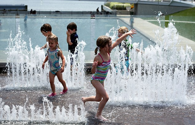 Making a splash: Weather forecasts predicted the hot weather will last in the city through Sunday
