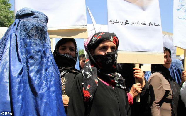 Fighting for equality: The women themselves - some with simple head scarves, others with veils, and others still wearing the full burqa - showed the confused and sometimes contradictory views concerning women in Afghanistan