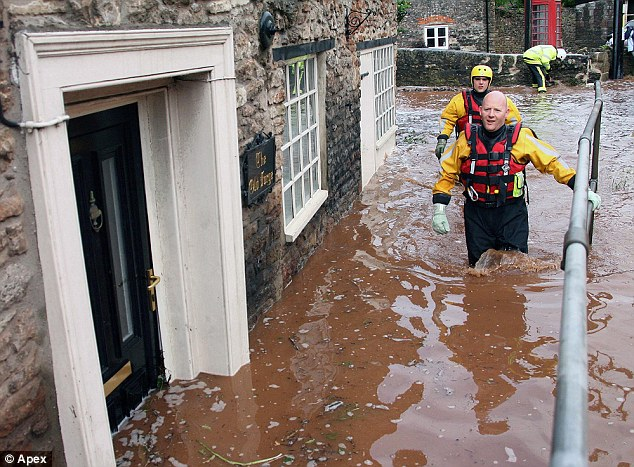 Rescue: In the south west, the village of Croscombe, Somerset, was the latest to find itself partly underwater today as the rain showed no sign of stopping
