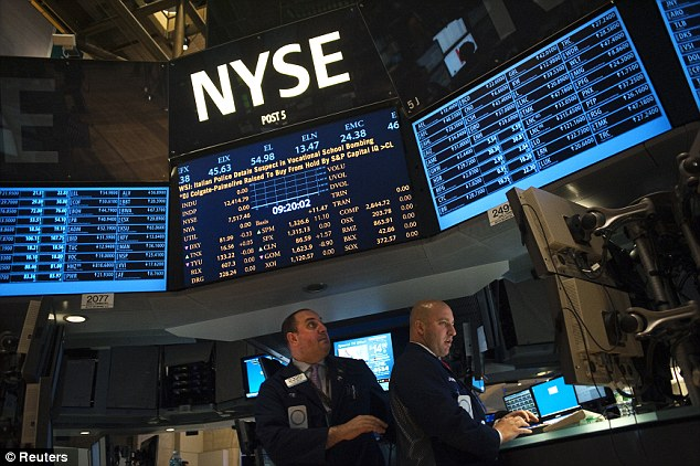 Traders work on the floor of the New York Stock Exchange in New York: It is alleged that the level of interest rate manipulation by the world's largest banks could have fraudulently affected billions of people across the world