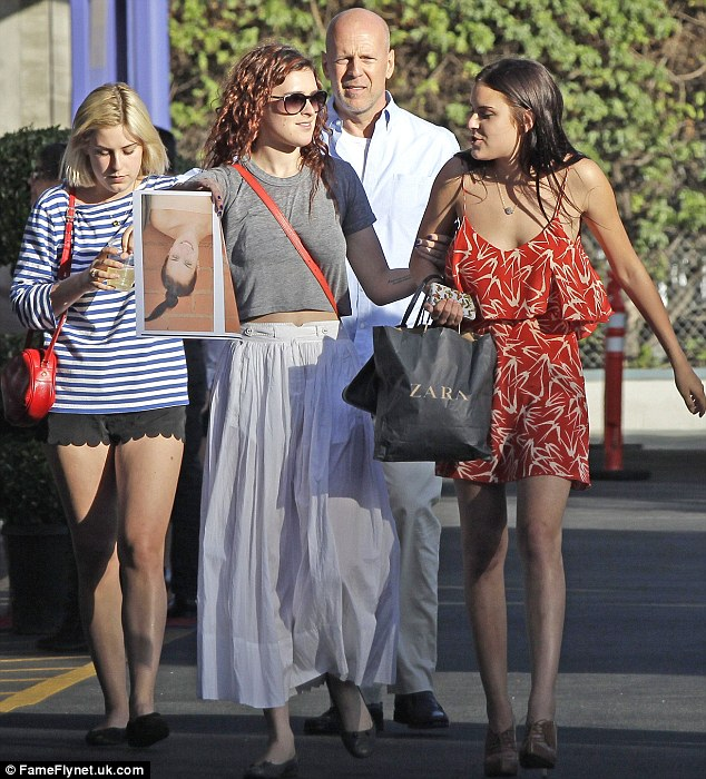 Jealous: Demi was reportedly cross that her girls appeared on better terms with their father Bruce Willis on the happy day
