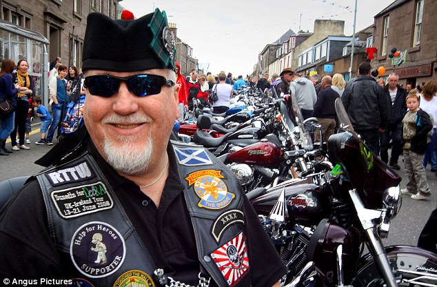 Happy times: A biker in the centre of Brechin where the Harley Davidson's gathered as they celebrated the restoration of Arthur and Mary Davidson's historic house