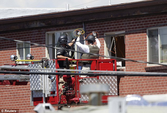 Wires: Specialists line a window with wires for an explosion at the apartment where suspect James Holmes lived in Aurora, Colorado