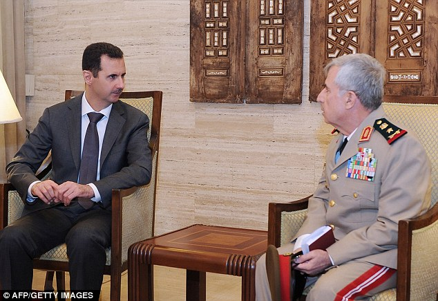 Under pressure: Syrian General Ali Abdullah Ayub, right, is pictured meeting with Syrian President Bashar al-Assad in Damascus