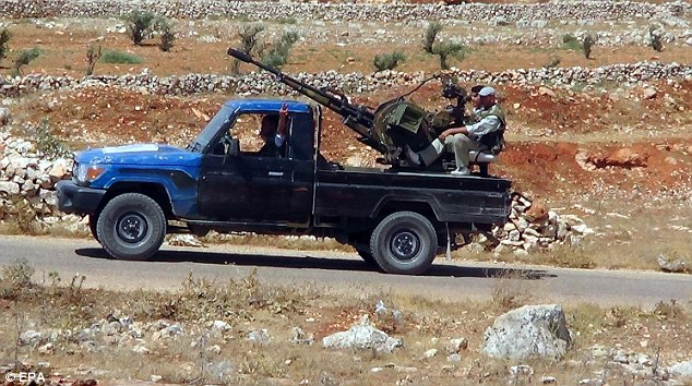 Fighting: Syrian rebels patrol with a pickup truck near Aleppo