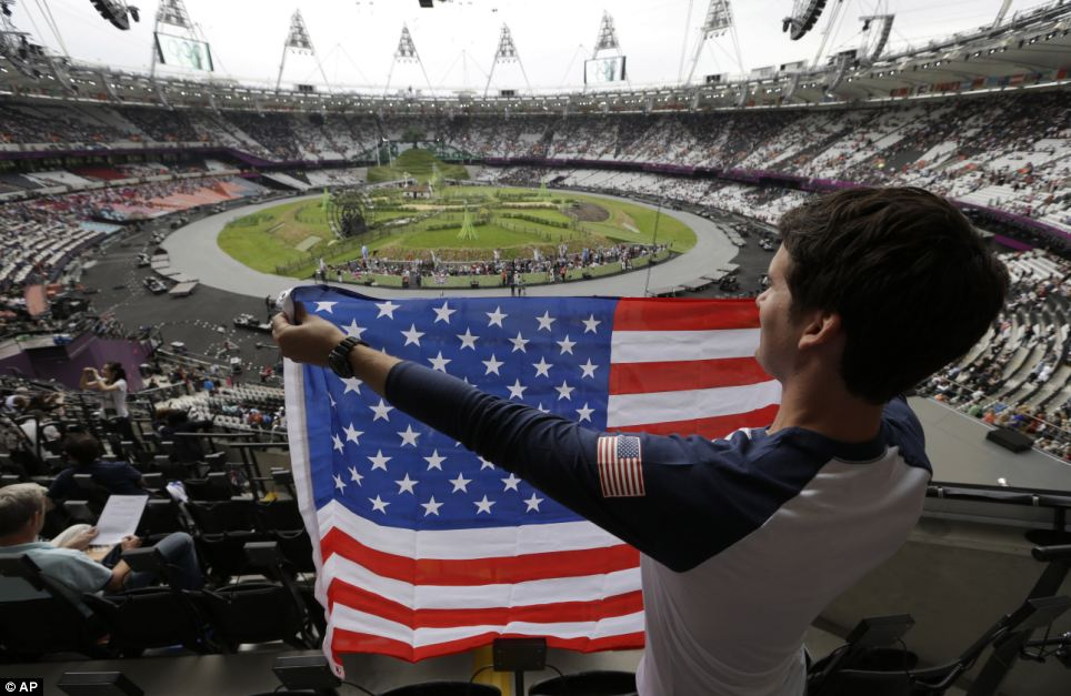 Oh look the Yanks have got there first: Ryan Musgrave of Chicago holds up a U.S. flag