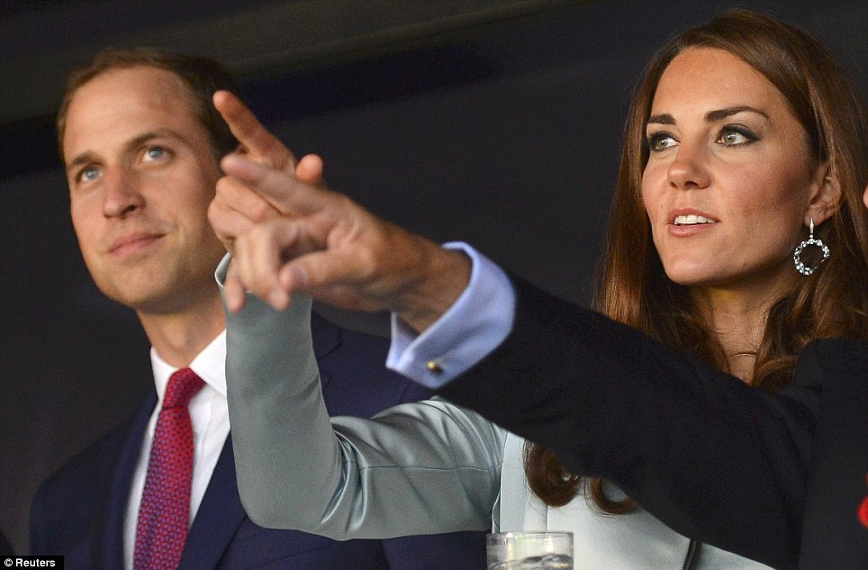 Prince William and his wife Catherine, Duchess of Cambridge take in the pre-show after arriving at the Opening Ceremony