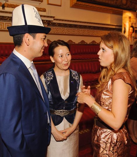 Princess Beatrice (right) speaks to the Prime Minister of Kyrgyzstan Omurbek Babanov (left) and Rita Birbaeva