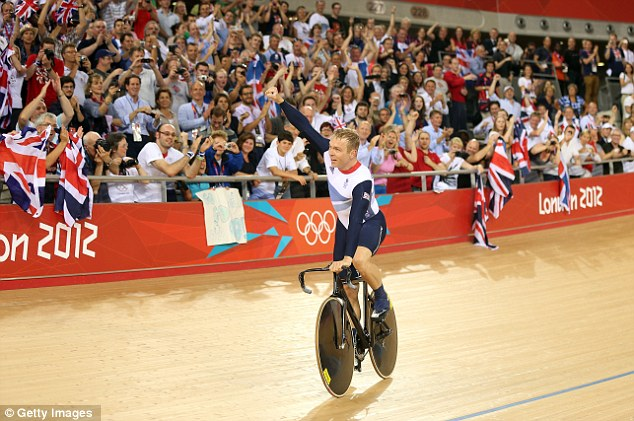 Proud to be British: Hoy soaks up the adulation of the fervent home support inside the Velodrome after his historic win