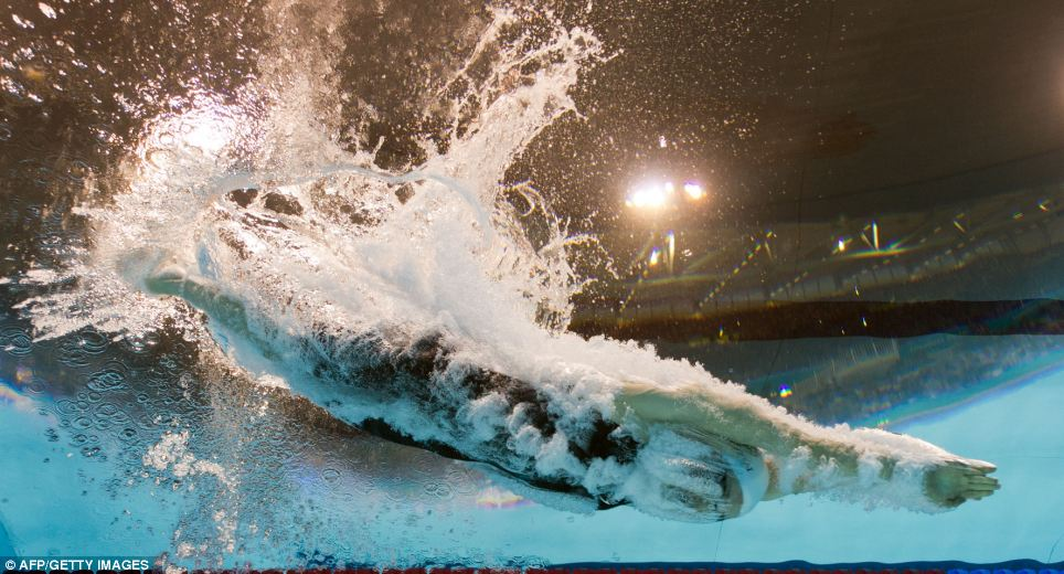 France's Camille Muffat dives in to the water during women's 200m freestyle final
