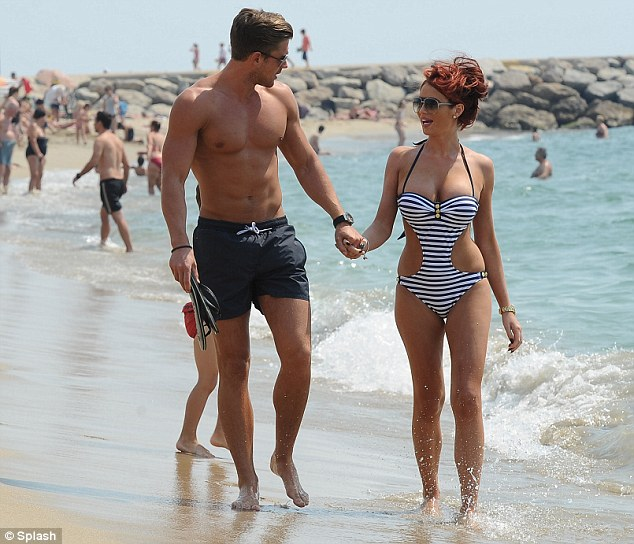 Crisis of confidence: Amy recently admitted she feels intimidated next to toned David