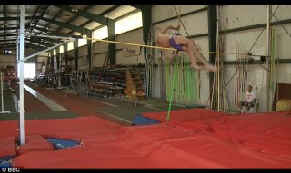 Record breaker: The 90-year-old recently smashed his own world record after clearing a staggering 7 feet 2 inches (218cm)