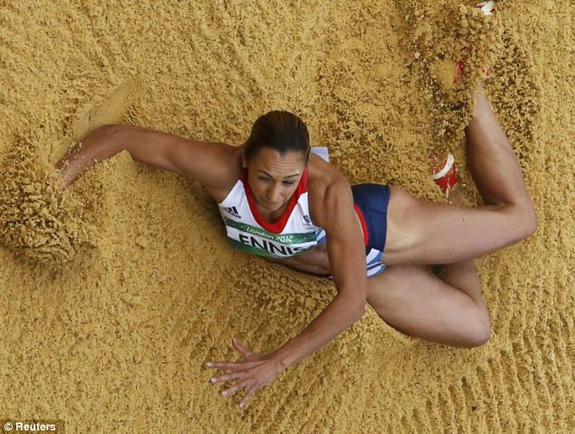Determined to achieve: A look of determination is etched on Ennis' face as she lands in the sand
