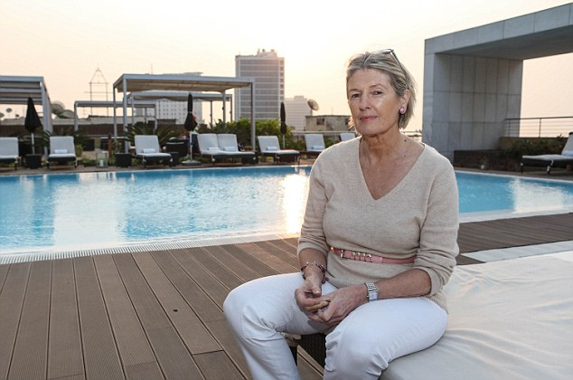 High life: Barbara Jones on one of the luxury hotel terraces that overlook Luanda¿s shanty towns