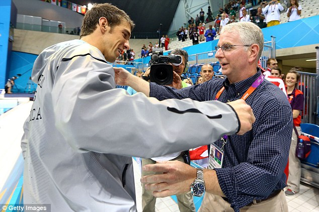 Hugs: Michael Phelps with his coach Bob Bowman after receiving a special award