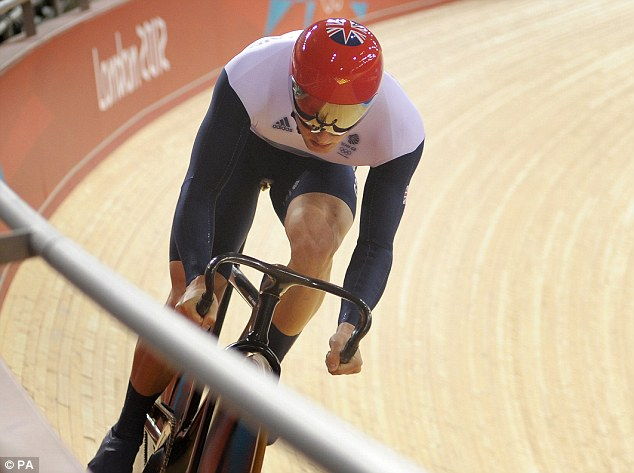 Wheels on fire: Ed Clancy, from Huddersfield, West Yorkshire, goes for gold in the velodrome at London 2012