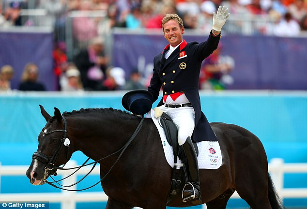 Carl Hester celebrates after a brilliant performance in the Team Dressage Grand Prix Special at Greenwich Park today