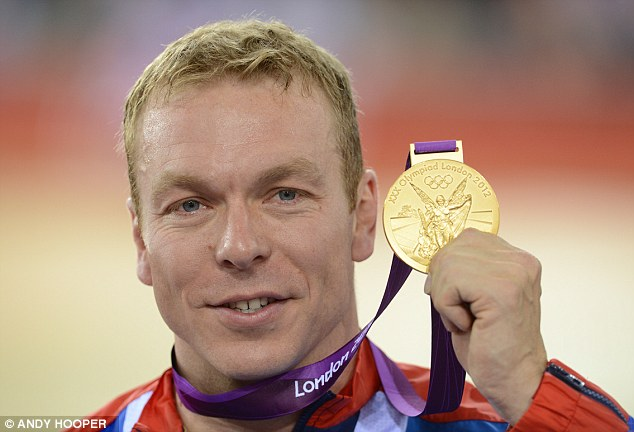 Another one: British cyclist Sir Chris Hoy holds his sixth gold medal after winning the keirin event
