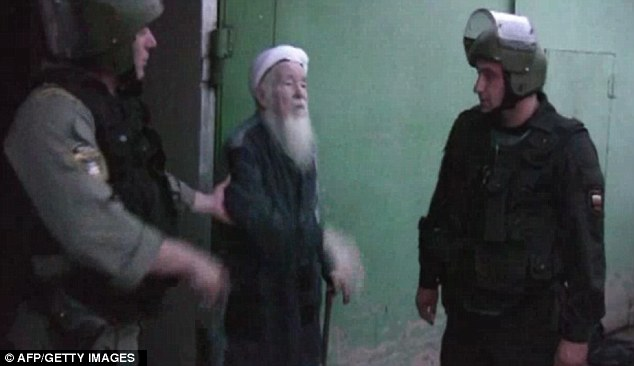 Underground leader: The local leader of the underground sect is led out of the cave in Kazan by Russian police in video footage released by the Government of Tatarstan