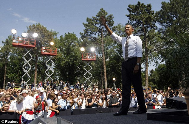 Whilst his half-brother inhabits a desolate Kenyan slum, U.S. President Barack Obama, pictured during an election campaign rally in Colorado Springs, is firmly in the limelight