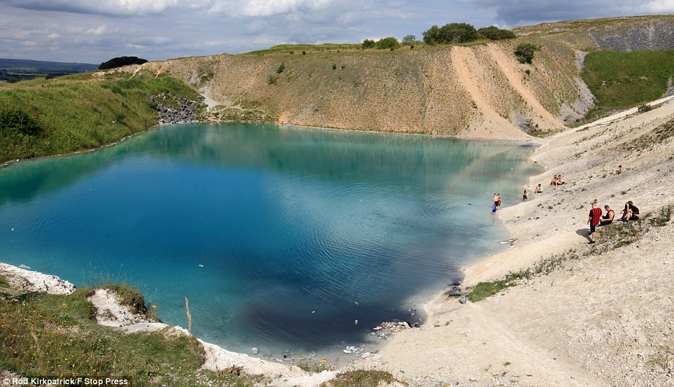 Families pitch up on the banks of the blue lagoon in Buxton, Derbyshire, ignoring warnings that the clear blue waters have pH levels almost as strong as bleach