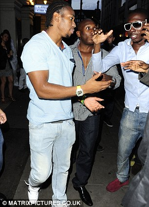 All smiles: Yohan Blake is mobbed by fans outside the club