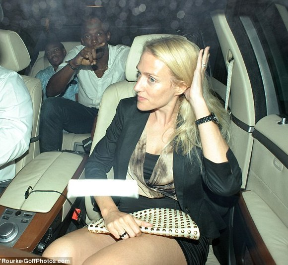 Heading home: Bolt and Blake were joined in their taxi home by a mystery blonde woman