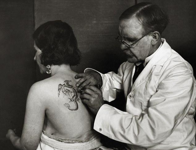 Girl with the dragon tattoo: An English woman wearing crystal earrings is seen getting her first tattoo in 1930