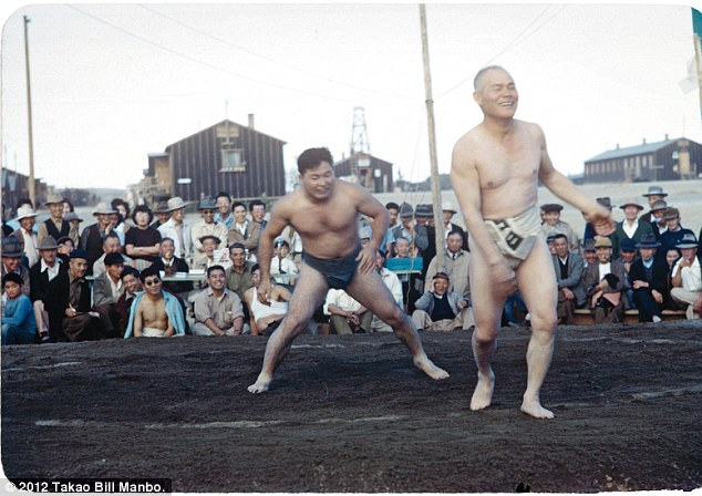 A light moment during a sumo wrestling match. Photo by Bill Manbo