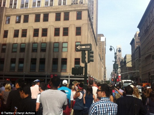 Crowds: People on their way to work gathered around the crime scene on 34th Street and Fifth Avenue