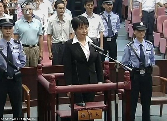 Gu Kailai, 53, is seen standing in the dock during the one-day trial this month. However rumours are circulating that the woman is in fact a body double hired by the wife of the Chinese premier