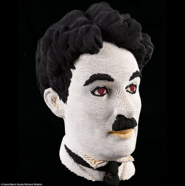 David Mach's take on Charlie Chaplin uses white, black and red matches mixed with wood