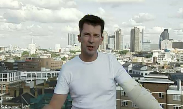 Captive: John Cantlie, who was shot in the arm when he tried to escape the camp in Syria, said his British-born captor planned to return to a role in the NHS