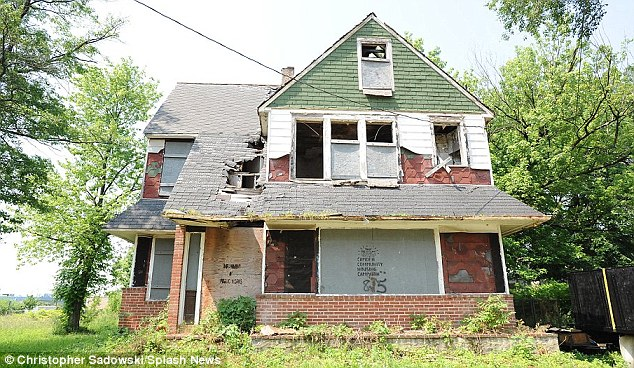 Run down: Crack houses have sprung up amid the boarded-up factories and burned out houses in Camden