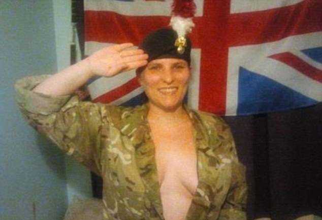 A feather in her cap: Patriotic supporter salutes before the Union Flag