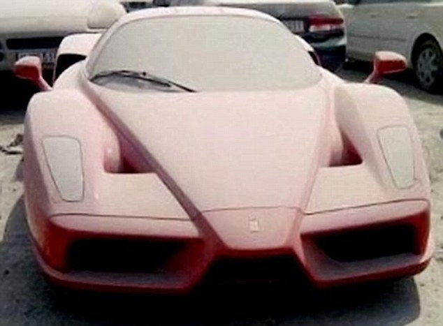 Sign of the times: Thousands of high-performance cars have been left abandoned at Dubai airport by expats who fear being jailed because they are in debt. This is a Ferrari Enzo worth £1million