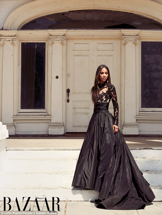 Ready for the ball: The actress towered on the steps of the broken down mansion in a sheer lace and organza gown